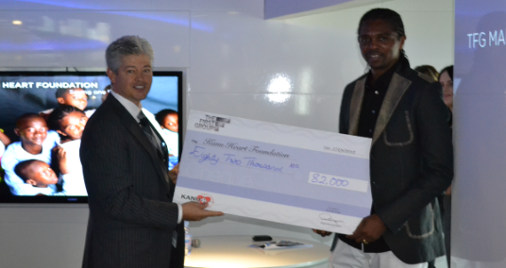 Team members donate to ambassador's charity to help underprivileged African children gain much needed heart surgery