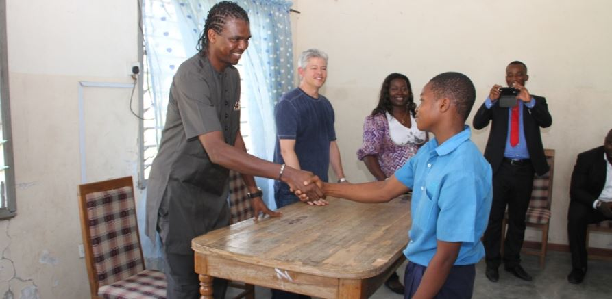 Football star Kanu joins The First Group on surprise visit to Abuja orphanage