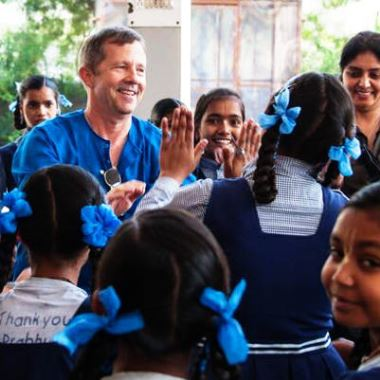 Charitable efforts in India witnessed first-hand as company founder visits new school built using company donations